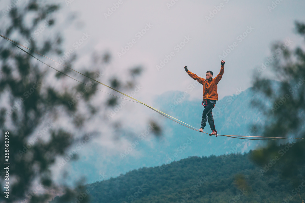 Fototapety, obrazy: Highline in the mountains.