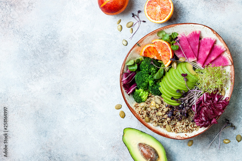 Poster Cuisine Vegan, detox Buddha bowl with quinoa, micro greens, avocado, blood orange, broccoli, watermelon radish, alfalfa seed sprouts. Top view, flat lay, copy space