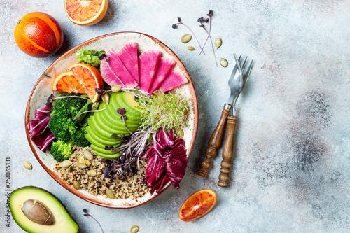 Fotografía  Vegan, detox Buddha bowl with quinoa, micro greens, avocado, blood orange, broccoli, watermelon radish, alfalfa seed sprouts
