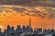 Leinwanddruck Bild - Dubai skyline in sunset orange colors