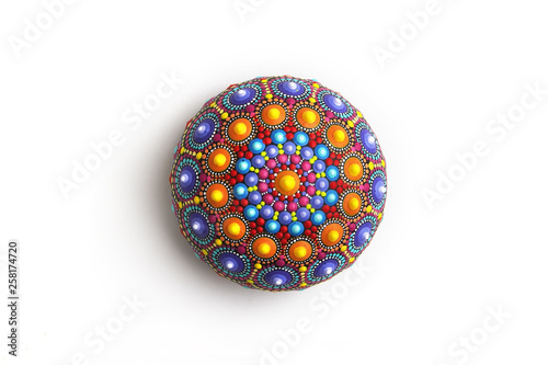 Beautiful mandala hand painted on a stone, isolated Wallpaper Mural