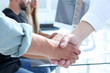 Business people shaking hands in the office after successful meeti