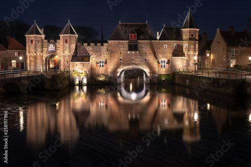 Medieval city gate as entrance over a flowing river; eem,  in Amersfoort holland