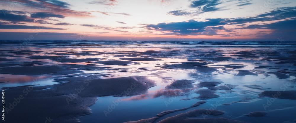 Fototapeta Sunset on porthtowan beach cornwall england uk