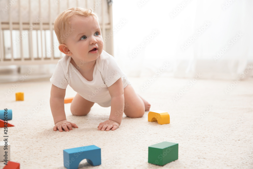 Fototapety, obrazy: Cute little baby crawling on carpet indoors, space for text