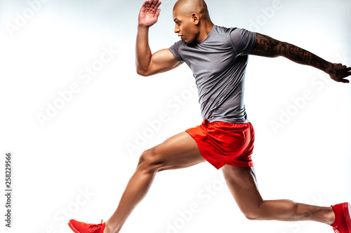 Athletics sportsman demonstrating his amazing running skills Canvas Print