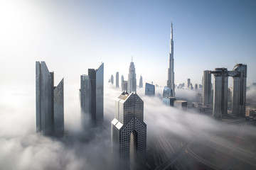 Cityscape of Dubai Downtown skyline on a foggy winter day. Dubai, UAE.