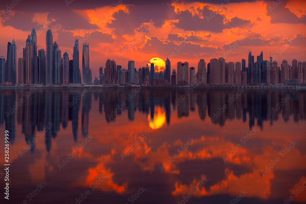 Fototapety, obrazy: Cityscape of many skyscrapers in Dubai city at popular residential part of town known as Marina and JBR towards idyllic sunrise.