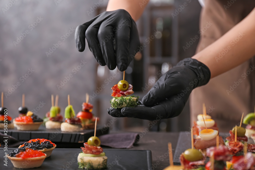 Fototapety, obrazy: Chef preparing tasty canapes for serving