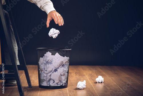 Fotografía Man Throwing Away Papers into Trash Bin, Inspiration, Creativity and Idea Concep