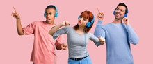 Group Of Three Friends Listening To Music With Headphones