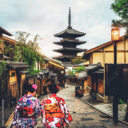 Photo Stands Japan Kyoto, Japan Culture Travel - Asian traveler wearing traditional Japanese kimono walking in Higashiyama district in the old town of Kyoto, Japan.