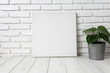 canvas print picture - Empty white canvas frame on a wooden table