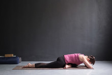 Woman Resting In One Legged King Pigeon Pose