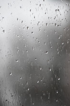 Rain Drops On Window Glasses Surface With Bokeh Background.