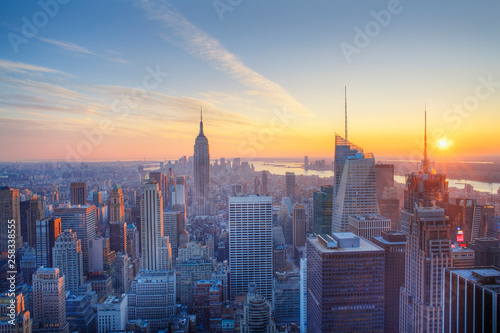 Fotografie, Obraz Empire State building and Manahttan skyline at sunset new york city new york usa