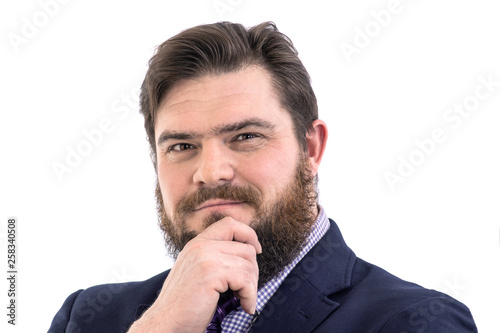 Fotografie, Obraz  Portrait of a big handsome pensive bearded business man in a dark suit and a bri