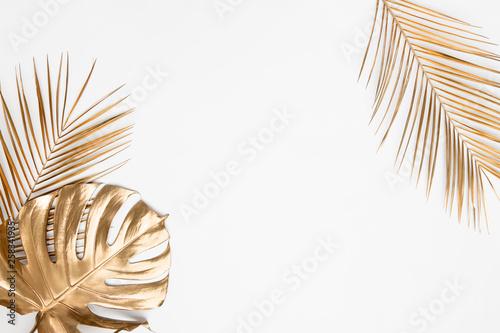 Obraz Golden tropical leaves on white background - fototapety do salonu