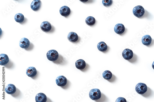 Fotografía Flatlay pattern with fresh ripe blueberries isolated on white background