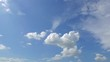 Timelapse of fluffy white clouds on a clear blue sky