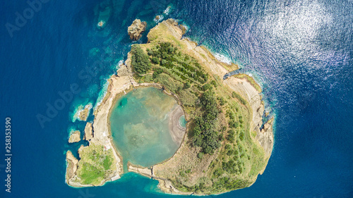 Foto auf Leinwand Blaue Nacht Top view of Islet of Vila Franca do Campo is formed by the crater of an old underwater volcano near San Miguel island, Azores, Portugal. Bird eye view, aerial panoramic view.
