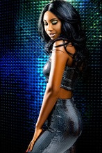 Attractive African Woman Against Disco Background.