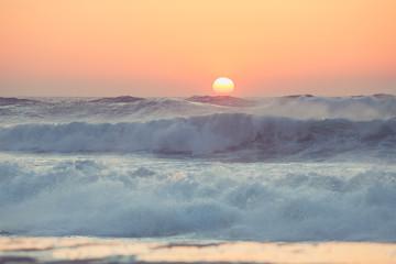 FototapetaSunrise and shining waves in ocean. Tropical beach panorama