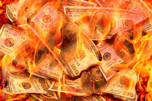 Foto Dollars Banknotes or bills of United States of America dollars burning in flame