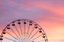 Ferris Wheel At The Sunset