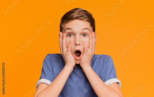 Fotografia, Obraz  Shocked boy opened his mouth in amazement