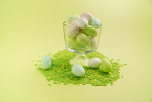 Eggs And Candy Sprinkles On Bright Spring Background