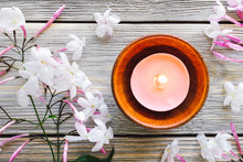 Teak Bowl With Lit Candle And Jasmine On White Washed Wood