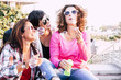 canvas print picture - Playful real life concept with three cheerful smiling middle age women friends anejoying and laughing togehter playing with soap bubbles in outdoor leisure activity - playful and happiness concept