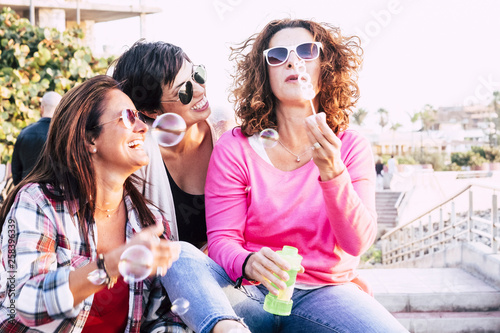 Playful real life concept with three cheerful smiling middle age women friends a Canvas Print