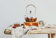 Glass Teapot On Wooden Table With White Wall
