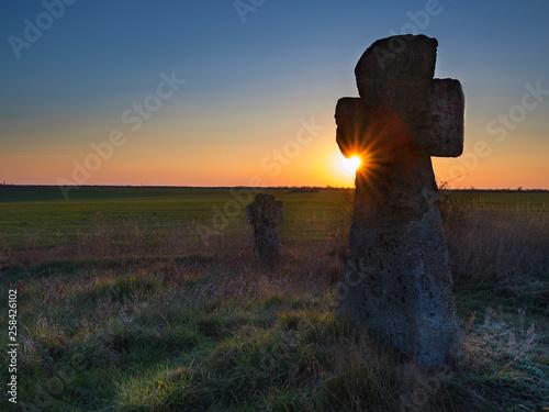 Montage in der Fensternische Braun old crosses on a cemetery in sun rays