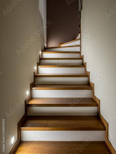 Wooden staircase illuminated Fototapete