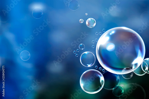 Fotografía  Soap bubbles floating in the green background vector