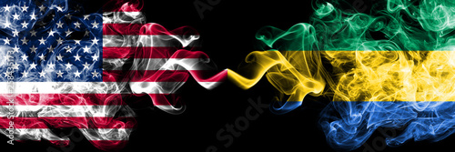 Fotografie, Obraz  United States of America vs Gabon, Gabonese smoky mystic flags placed side by side