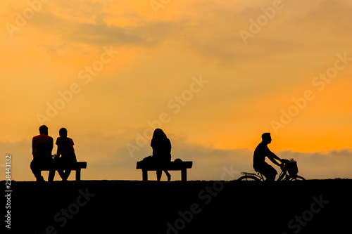 Aluminium Prints Cycling people relax at sunset. (Soft focus)