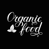 Organic food hand written phrase with leaves isolated on black background. Calligraphy lettering sign. Healthy food concept. Vector logo design  for fresh market, restaurant, farm, store, etc. - 258445505