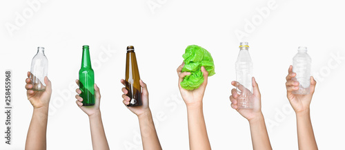 Valokuva  hand holding garbage of bottle glass and bottle plastic with plastic bag isolate