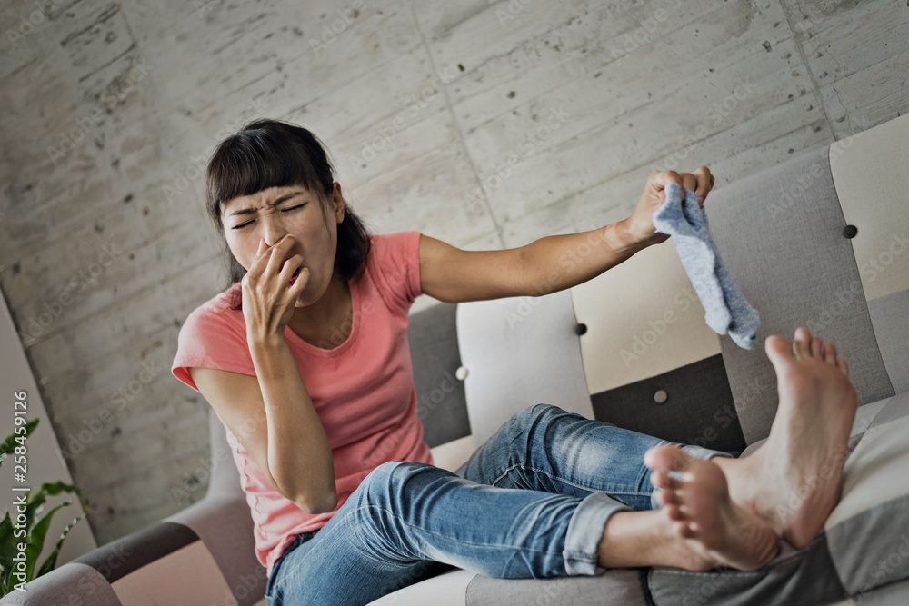 Fototapety, obrazy: woman holding dirty sock