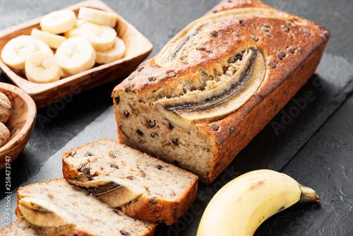 Fototapeta Homemade banana bread with walnut and cinnamon.