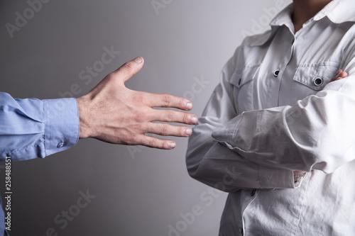 Business girl refusing male hand to shake. Tapéta, Fotótapéta