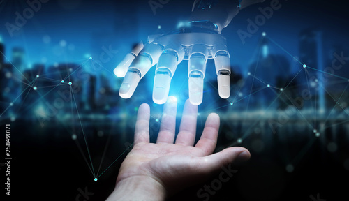 Fototapeta Robot hand making contact with human hand on dark background 3D rendering obraz