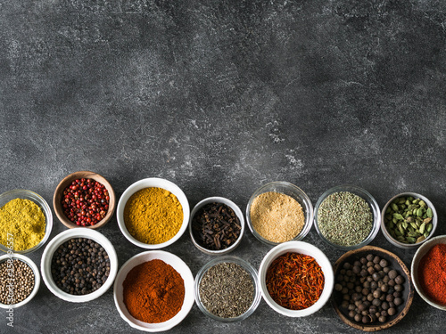 Printed kitchen splashbacks Spices Various dry spices flat lay in small bowls on gray background. Top view, copy space