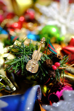 Colorful Assortment Of Christmas Ornaments With Blurry Background