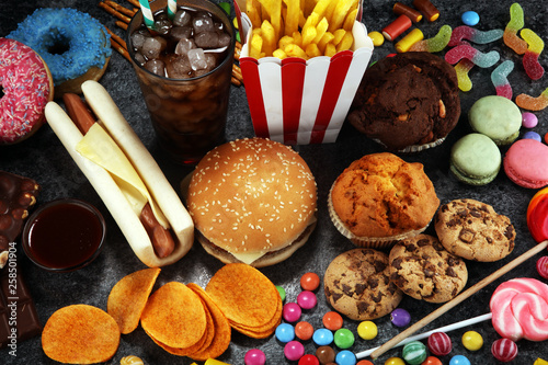 Fotografie, Obraz  Unhealthy products. food bad for figure, skin, heart and teeth.