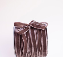 A Hank Of Brown Velvet Ribbon With Bow